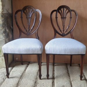 Pair of mahogany side chairs by Holland and Sons chairs Antique Chairs