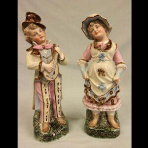 Antique Glazed & Bisque Porcelain Pair of Figurines.