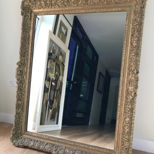 Original late 18th, early 19th Century carved and gilded frame with mirror glass (modern). The frame is mitred and jointed to the reverse. The corners and centres are in good condition for it's age, but with some minor damage here and there. Carved frame Antique Mirrors