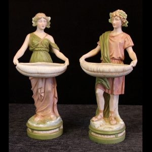 Pair Antique Royal Dux Porcelain Figurines of young man and woman