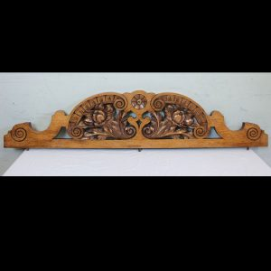 Antique Late Victorian Carved Oak Pediment. This lovely shaped late Victorian oak pediment has carved and scroll detail.