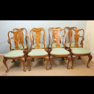 Set of Eight Queen Anne Style Walnut Dining Chairs.