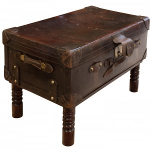Leather suitcase on later stand Miscellaneous