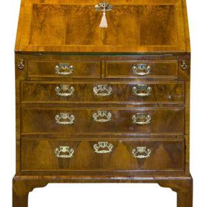 A Queen Anne walnut and feather banded bureau Antique Bureau